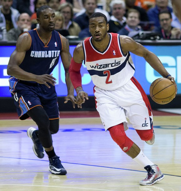 John Wall gritted his teeth and choked back tears as Washington Wizards executives announced details of the star guard's new ...
