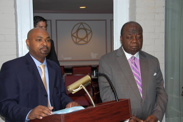 Elliston Rahming (right), Bahamian Ambassador to the U.S. and permanent representative to the Organization of American States, and Deputy Chief of Mission Chet Neymour respond to questions from guests who attended a reception at the Bahamas Embassy in Washington, D.C. on Monday, Aug. 5.