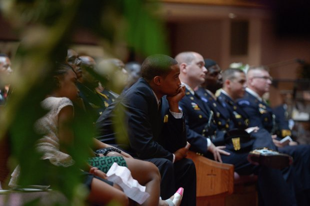 Rodney Bunn, the son of the late James Bunn, listens as his father is eulogized by a host of speakers during his funeral service at Matthews Memorial Church in Southeast on Friday, Aug. 9. Bunn, chairman of the Congress Heights Main Streets Organization and the Ward 8 Business Council, died Aug. 1.
