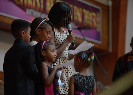 The grandchildren of the late James Bunn give a tribute during his funeral service at Matthews Memorial Church in Southeast on Friday, Aug. 9. Bunn, chairman of the Congress Heights Main Streets Organization and the Ward 8 Business Council, died Aug. 1.