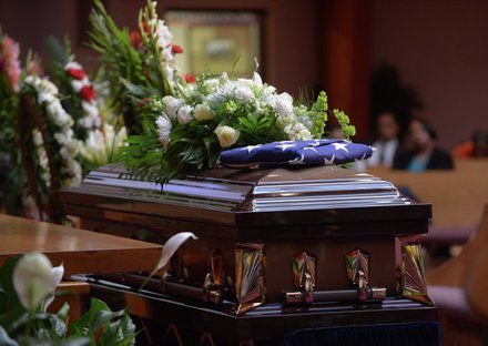The casket of the late James Bunn lays in repose at Matthews Memorial Church in Southeast as family and friends honor him during his funeral service on Friday, Aug. 9. Bunn, chairman of the Congress Heights Main Streets Organization and the Ward 8 Business Council, died Aug. 1.