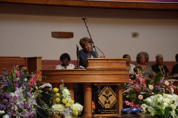 ANC Commissioner Mary Cuthbert offers remarks during the funeral service for James Bunn at Matthews Memorial Church in Southeast on Friday, Aug. 9. Bunn, chairman of the Congress Heights Main Streets Organization and the Ward 8 Business Council, died Aug. 1.