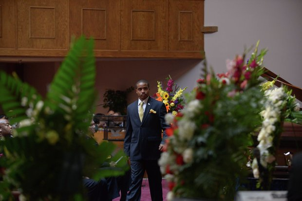 Rodney Bunn, the son of the late James Bunn, walks to his seat during the funeral service for his father at Matthews Memorial Church in Southeast on Friday, Aug. 9. Bunn, chairman of the Congress Heights Main Streets Organization and the Ward 8 Business Council, died Aug. 1.