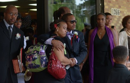 James Bunn II (right) comforts his sister, Sheila Bunn, as they exit Matthews Memorial Church in Southeast on Friday, Aug. 9, after the funeral service for their father, James Bunn. Bunn, chairman of the Congress Heights Main Streets Organization and the Ward 8 Business Council, died Aug. 1.