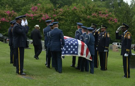The Air Force Honor Guard carries the flag-draped coffin of James Bunn to its final resting place at  National Harmony Memorial Park in Largo, Md., on Friday, Aug. 9. Bunn, chairman of the Congress Heights Main Streets Organization and the Ward 8 Business Council, died Aug. 1.