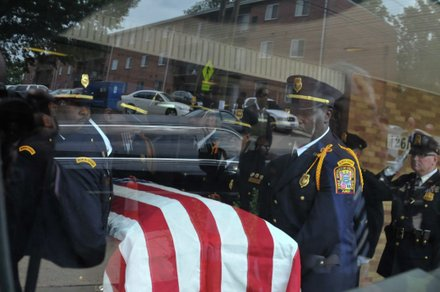 Members of the D.C. Fire Department Honor Guard place the casket of James Bunn into a hearse on Friday, Aug. 9. Bunn, chairman of the Congress Heights Main Streets Organization and the Ward 8 Business Council, died Aug. 1.