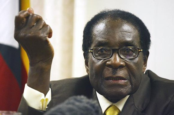 ZIMBABEWE, Africa — Zimbabwean President Robert Mugabe said Monday the West and his political opponents can commit suicide if they ...