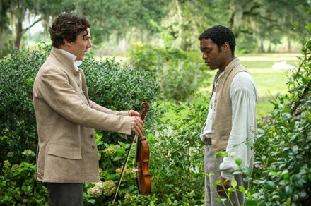 "Benedict Cumberbatch as ""William Ford"" and Chiwetel Ejiofor as ""Solomon Northup"" in Steve McQueens's ""12 Years A Slave."""