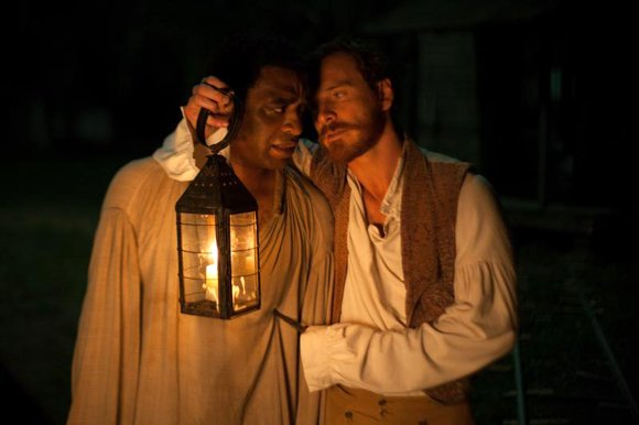 "Chiwetel Ejiofor as ""Solomon Northup"" and Michael Fassbender as ""Edwin Epps"" in Steve McQueens's ""12 Years A Slave."""