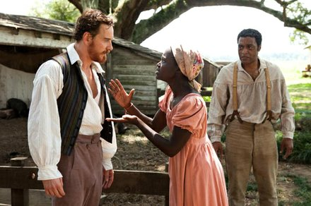 "Michael Fassbender as ""Edwin Epps,"" Lupita Nyong'o as ""Patsey"" and Chiwetel Ejiofor as ""Solomon Northup"" in Steve McQueens's ""12 Years A Slave."""