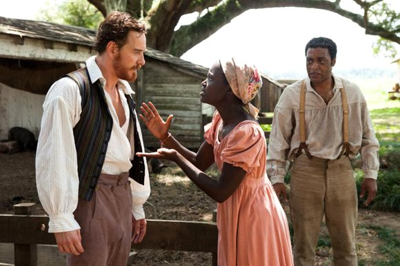 """Michael Fassbender as """"Edwin Epps,"""" Lupita Nyong'o as """"Patsey"""" and Chiwetel Ejiofor as """"Solomon Northup"""" in Steve McQueens's """"12 Years A Slave."""""""