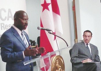Charles Thornton, director of the Mayor's Office on Returning Citizen Affairs in D.C., speaks during the Aug. 6 official opening ceremony of the office's Re-Entry Resource Center in Southeast. At right is D.C. Mayor Vincent Gray.