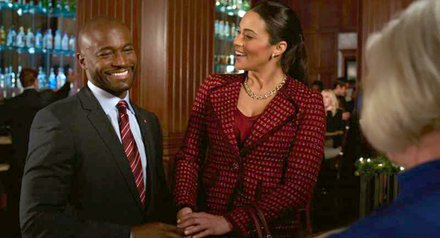 "Taye Diggs as ""Langston"" and Paula Patton as ""Montana Moore"" in ""Baggage Claim."""