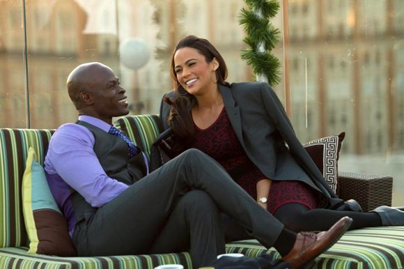 "Djimon Hounsou ""Quinton"" and Paula Patton as ""Montana Moore"" in ""Baggage Claim."""