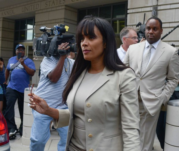Sandi Jackson, wife of former Illinois Rep. Jesse Jackson Jr., leaves the U.S. District Courthouse in D.C., on Wednesday, Aug. 14 after she was sentenced to 12 months in prison for failing to report almost $600,000 in taxable income.
