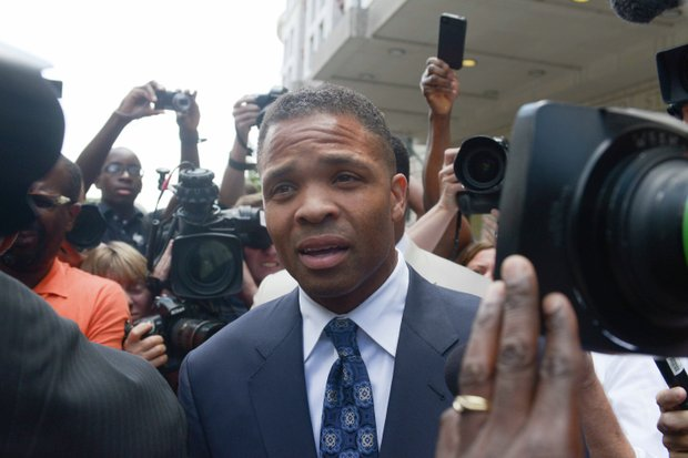 Former Illinois Rep. Jesse Jackson Jr.  is surrounded by members of the press and onlookers as he leaves the U.S. District Courthouse in D.C., on Wednesday, Aug. 14 after he was sentenced to 30 months in prison for misuse of campaign funds.