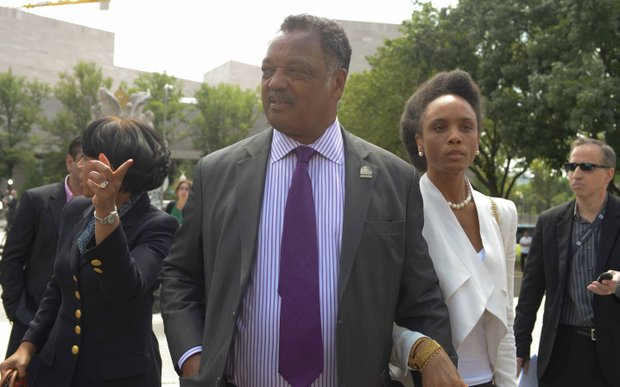 The Rev. Jesse Jackson Sr. leaves the U.S. District Courthouse in D.C., on Wednesday, Aug. 14 with his daughter Jacqueline (right) after attending sentencing hearings for Former Illinois Rep. Jesse Jackson Jr. and his wife Sandi for felony charges related to misuse of campaign funds and failing to report taxable income.