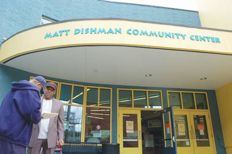 Ernest Richie gathers signatures to his petition outside of Matt Dishman Community Center in northeast Portland. He's part of an effort to permanently return relics from the center's historic Knott Street Boxing program to its former sole trophy display case.