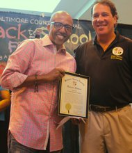 "(Right) Kevin Liles received a plaque from Baltimore County Executive Kevin Kamenetz at the ""Kevin Liles for a Better Baltimore Foundation"" back to school event last year. The back to school festival this year will be held on Saturday, August 24, 2013 at Security Square Mall from noon to 4 p.m."