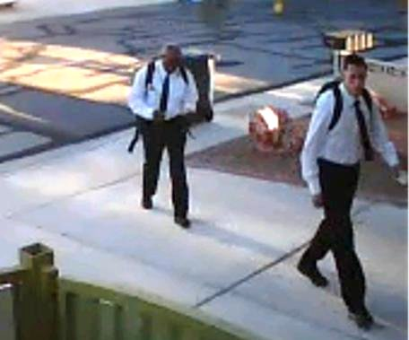 "On June 27, 2013 at approximately 6:20 a.m., the suspects pictured committed a residential robbery in the area of Flamingo and Buffalo. The suspects, dressed like Mormon missionaries, knocked on the victim's door asking to speak to him about religion. The victim spoke to them for approximately five minutes and was then jumped and punched by the suspects. The suspects demanded property from the victim while holding him at gunpoint. Once receiving property from the victim, the suspects fled. Suspect #1 is described as a White male, 22-28 years old, 5'7""-5'8"", 130-145 lbs. He was last seen wearing a white shirt, black tie, black pants and black shoes. He was carrying a black backpack and was armed with a handgun. Suspect #2 is described as a Black male, 22-28 years old, 5'10""-6'1"", 190-210 lbs. He was last seen wearing a white shirt, black tie, black pants and black shoes."