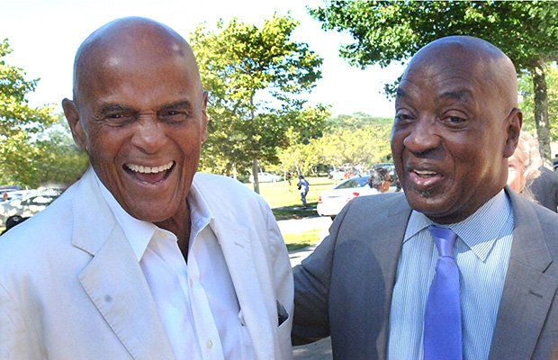Legendary entertainer and social justice activist, Harry Belafonte (L) shares a laugh with Harvard Law Professor Charles Ogetree Jr. (R) after speaking at a health forum sponsored by Ogletree's Charles Hamilton Houston Institute on Martha's Vineyard. Belafonte was given a special musical tribute by Larry Watson during the event.