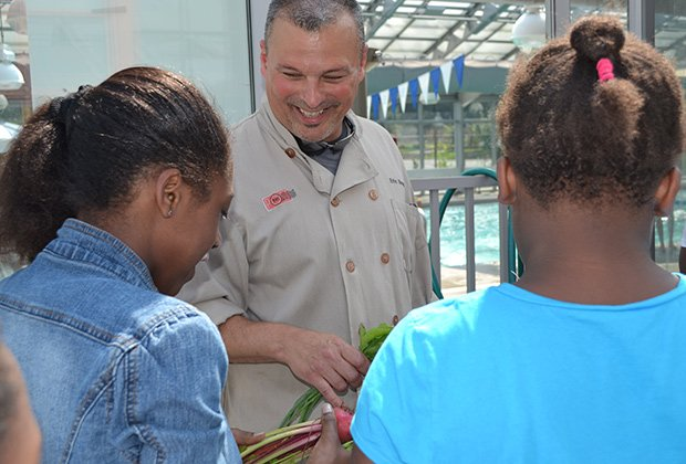 Chef Eric Brennan (pictured above) of Post 390 and Chris Himmel, the restaurant's owner, visited the Blue Hill Boys and Girls Club and used fresh ingredients from their outdoor garden to create grilled pizzas.