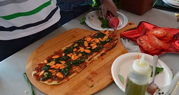Chef Eric Brennan of Post 390 and Chris Himmel, the restaurant's owner, visited the Blue Hill Boys and Girls Club and used fresh ingredients from their outdoor garden to create grilled pizzas.