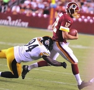 Washington Redskins QB quarterback Kirk Cousins (12) is tackled by Pittsburgh Steelers LB Lawrence Timmons  during the Redskins' 24-13 preseason victory at FedEx Field in Landover, Md., on Aug. 19, 2013.