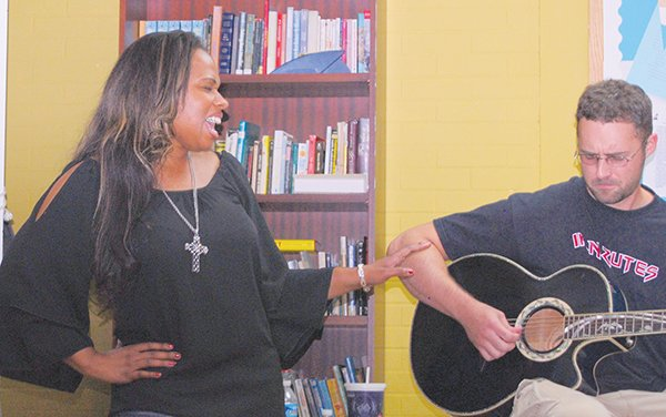 """Adrianna Freeman with Mark Hawkins at the Sasha Bruce House in Southeast on Friday, Aug. 16. Freeman penned the song """"Just A Girl,"""" which addresses the many challenges that children who grow up in dysfunctional families face."""