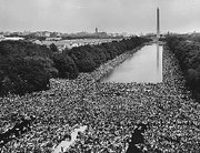 "More than 200,000 people attended the 1963 ""March on Washington."" A wide-angle view of marchers along the mall shows the Lincoln Memorial Reflecting Pool and the Washington Monument."
