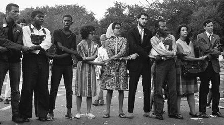 People holding hands during the 1963 March on Washington.