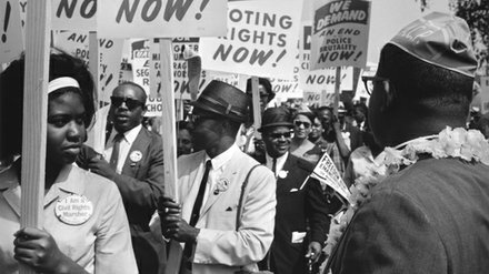 Protestors holding signs during the 1963 March on Washington.