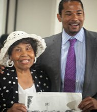 Nettie Hailes with Comcast Government Affairs Director Antonio Williams displaying a photo taken during the 1963 March on Washington at the Black Women's Roundtable on Thurs., August 22 at the Hyatt Regency Capitol Hill in Northwest.