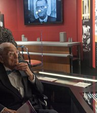 """Simeon Booker and his wife view the Civil Rights exhibit at the Newseum during the """"Covering Civil Rights: On the Front Lines,"""" event Thurs., August 22."""