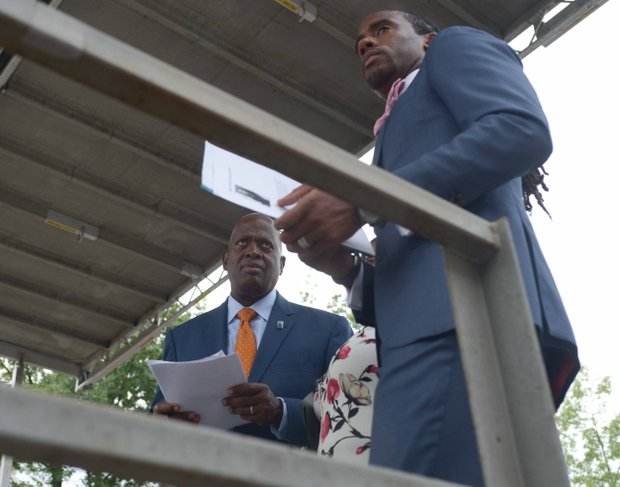 Harry Johnson (left), Martin Luther King Memorial Foundation president, talks with Journalist and motivational speaker Jeff Johnson during the Drum Majors for Justice Future Leaders Celebration at Freedom Plaza in Northwest on Fri., August 23.