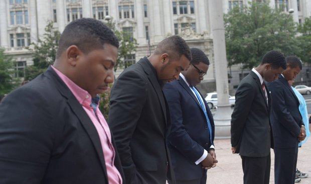 Students from South Carolina State University pray during the Drum Majors for Justice Future Leaders Celebration at Freedom Plaza in Northwest on Fri., August 23.