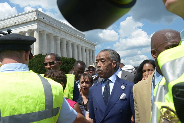 Rev. Al Sharpton, center, and other dignitaries en route to the Washington Monument after speaking during the March on Washington 50th Anniversary on Sat., August 24.