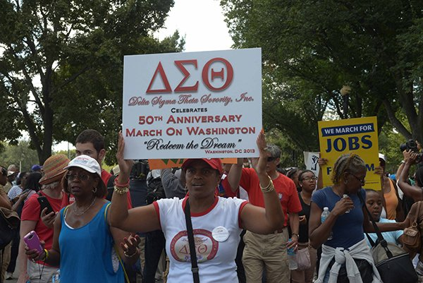 A sorority member proudly displays the Delta Sigma Theta insignia at the March on Washington 50th Anniversary on Sat., August 24.