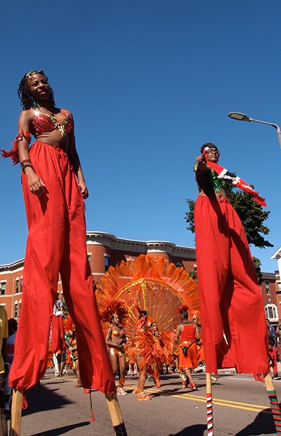 Stilt walkers with the New York-based group, Brooklyn Jumpers, march on the Caribbean Carnival parade route.
