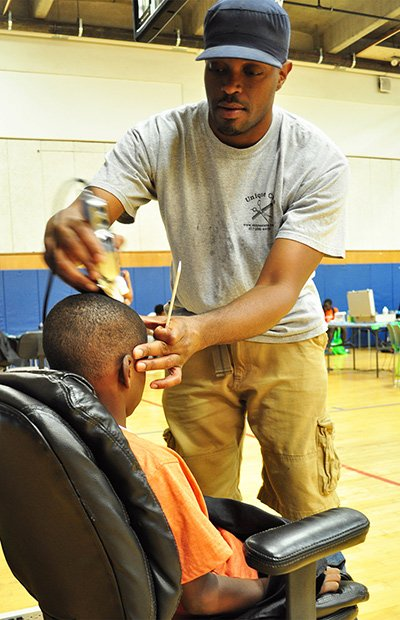 "Dorchester House hosted the ""First Impressions Fair"" on Monday, August 26 to help prepare youth for the upcoming school year. Manny Cardoso from Unique Cuts was one of the local barbers that provided 40 free haircuts. In addition, Dorchester House pediatrics and dental staff provided healthcare, hygiene and school supplies to students."