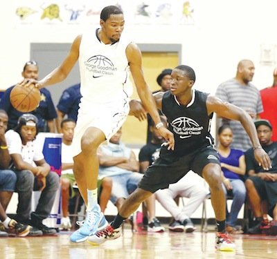 Victor Oladipo (right) and Kevin Durant face off at the Goodman League Roundball Classic on Sunday, Aug. 25 at DeMatha Catholic High School in Hyattsville, Md.