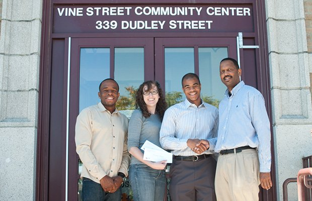 Vine Street Community Center Council awarded their first scholarship on Aug. 24. The Pizzi Family Foundation was a donor. (L-R) Awardee Asad Hardwick, Andrea Pizzi, awardee Jamal Ellison and David Hinton, coordinator of Vine Street Community Center. Not present were awardees Marysabel Mejia and Nair Andrade.