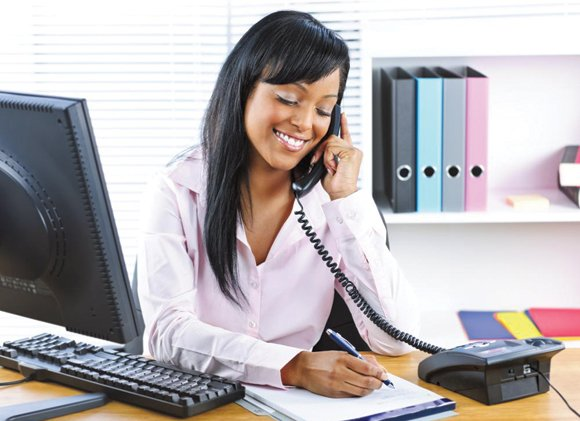 Administrative assistant working in an office.