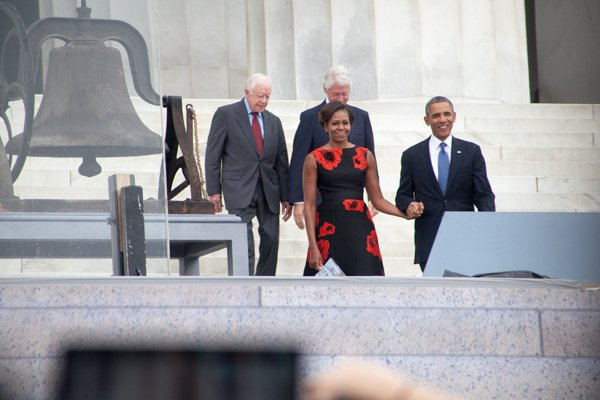 President Obama arrives with his wife Michelle and former Presidents Jimmy Carter and Bill Clinton