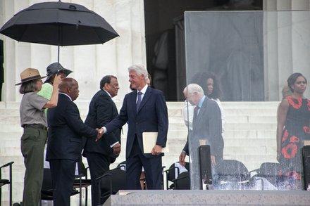 Former President Bill Clinton greets Congressman John Lewis