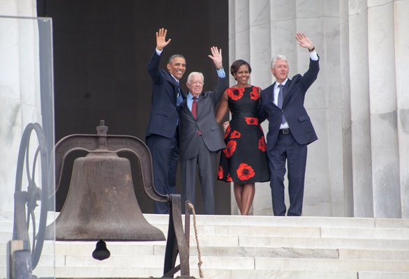 """President Obama and First Lady Michelle, Former Presidents Jimmy Carter and Bill Clinton wave to the crowd from the steps of the Lincoln Memorial during the """"Let Freedom Ring"""" commemoration and call to action program on Wednesday, August 28."""