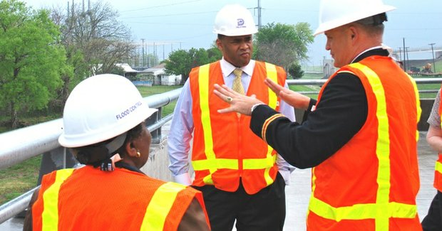 Col. Charles H. Klinge, commander, U.S. Army Corps of Engineers-Fort Worth District, briefs Dallas City Councilwoman Vonciel Jones Hill and U.S. Rep. Marc Veasey, District 33, on the benefits that the new Pavaho Pump Station delivers to reduce flood risk to this West Dallas neighborhood.