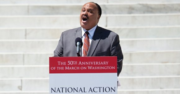 "The task is not done, the journey is not complete,"" Martin Luther King III said. He was standing in the ..."