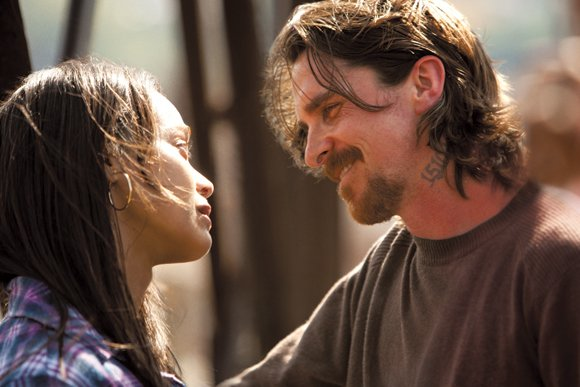 "Zoe Saldana and Christian Bale star in Relativity Media's ""Out of the Furnace."""