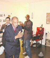 Rep. John Conyers (D-Mich.) says a few words at a party celebrating We Act Radio's one-year anniversary. In 2009, the congressman introduced a bill that obligated radio stations to pay musicians for records played on the air. The legislation and other events inspired the creation of We Act Radio. (Courtesy of We Act Radio)